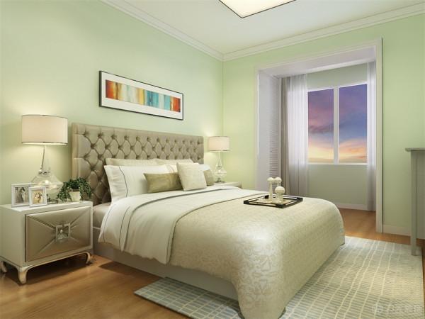 主卧室刷果绿色乳胶漆。床头背景简单的挂画。