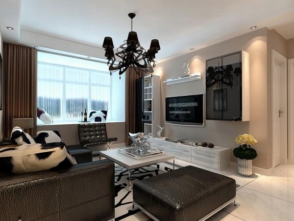 客厅的电视背景墙两边是以黑白烤漆组合柜做了一个简单而又美观的造型,墙体是以浅咖色乳胶漆为整体,电视柜是以白色烤漆组成。