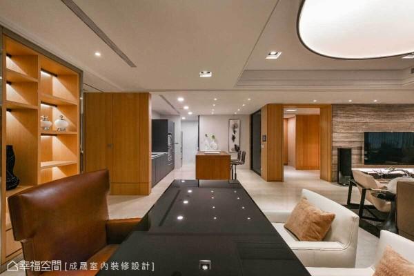 拉大内部的尺度,将开放式书房连结厨房空间,并藉由线与面的铺设,带来丰富的立面层次。