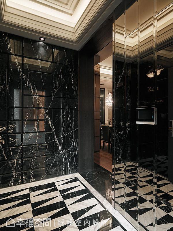 石材拼花图案地坪,搭配反射材质的立面,以及线条层层堆栈的天花板,让玄关大器恢弘。