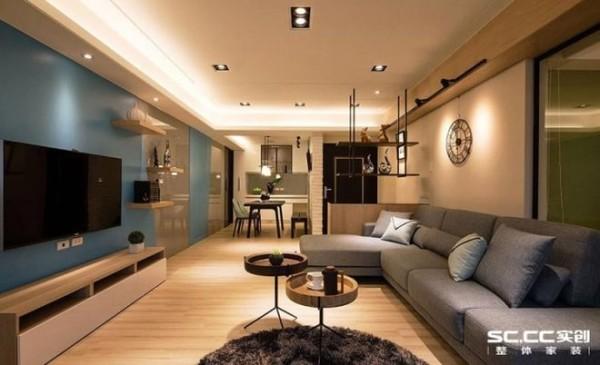 汉实创装饰的设计师以三方底座概念纳入架高地板规划,扩增客厅使用功能。 特调过的水蓝色与抹茶绿色,交融出缤纷活泼的空间氛围。