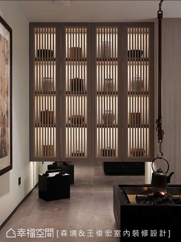 吊壶地炉与格栅书柜的设计,皆是以现代手法重现经典东方元素。