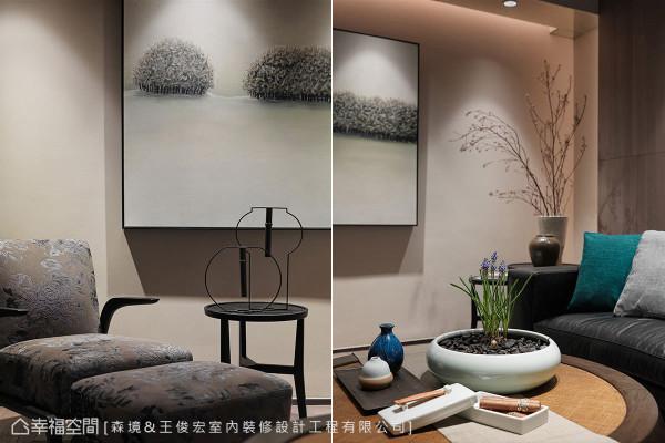 艺术挂画、中式灯笼造型桌饰、酒器与盆花,都是王俊宏设计师的精心佳作。