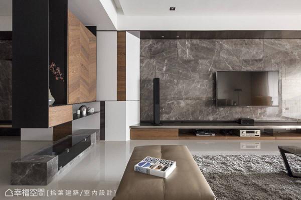 大理石打造的电视墙面展现恢弘气势,左侧屏风设计则发挥美学展示功能,同时软化刚硬的风格色彩。