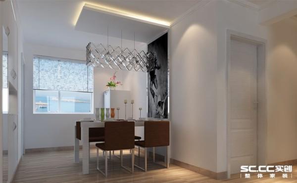 为了更好的配合客厅的颜色搭配,来做出一些更好的配色,运用黑白的装饰画和整体呼应,白色餐桌点缀在空间中,让餐饮更加纯洁