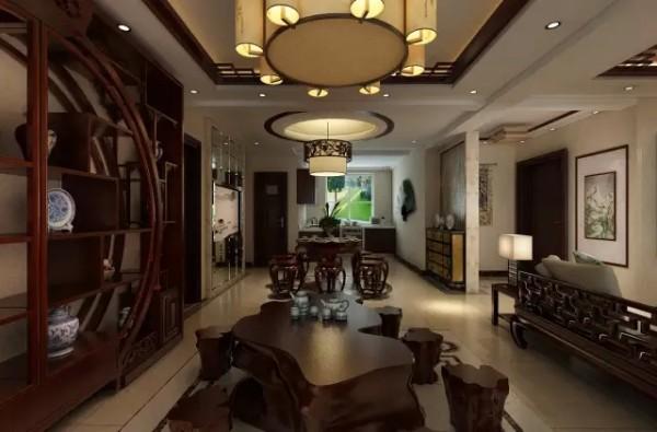 地面石材拼花与墙面上的金色镂空雕刻画显得雍容华贵。造型简洁的酒柜中间配以银镜,上面镶嵌一幅抽象山水画,让空间氛围独有一种精致和轻巧。