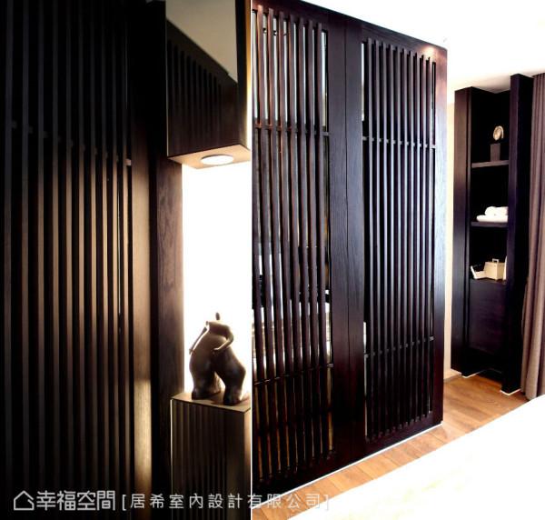 居希室内设计透过格栅式设计的衣柜门片,除了有隔屏的效果,也顺势规划出主卧端景。