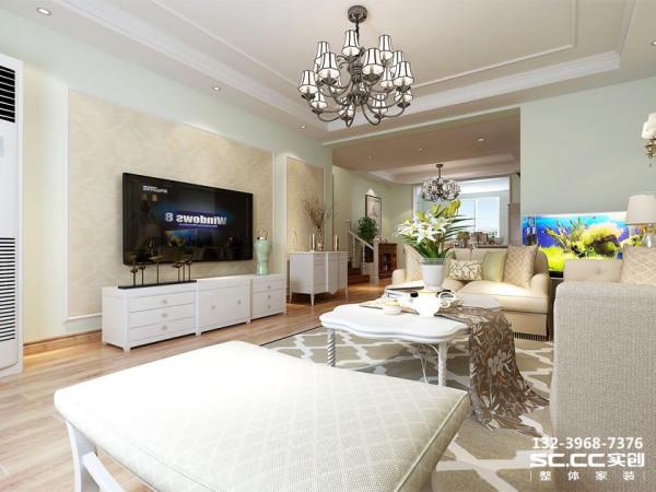 电视背景墙采用和沙发背景墙相同的设计手法,使之具有整体性。