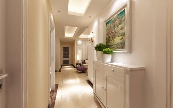 门厅设计: 墙上挂满了各式画作,让室内洋溢着浓厚的艺术气息,体现了主人的艺术品位和格调,也丰富了室内空间。