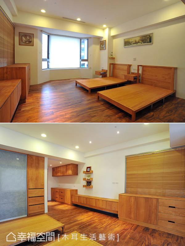 同样以实木装设而成的房间显得温润洁简,回纹型的床边柜与大面木作橱柜让收纳不成问题,玻璃门片后则为衣柜位置。