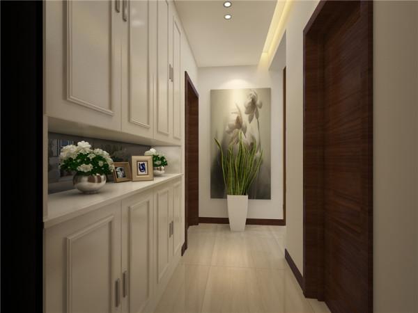 设计理念:玄关白色的中空柜体,门板上的线条造型,让整个柜体极具现代感。 亮点:中空柜体代言的生活的现代感。
