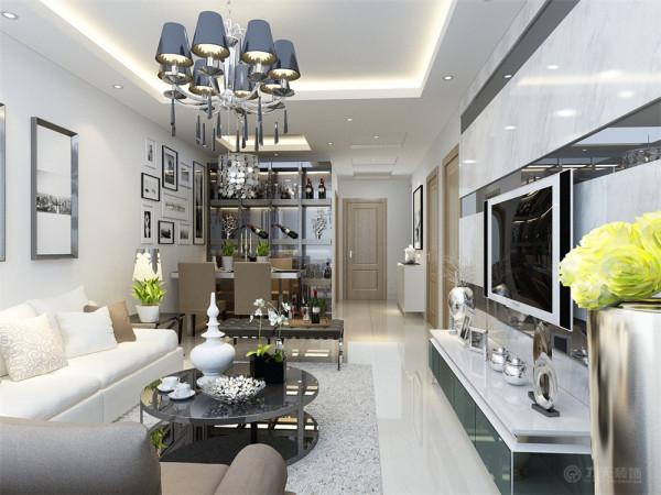 经和业主沟通后,最终我们将本案定义为现代简约风格。客餐厅区域保留白色墙面,客厅区域和餐厅区域都使用回字形吊顶,过道吊顶使用简单的镂空设计,内放筒灯。