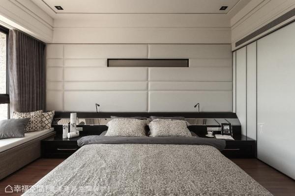 床头墙面以绷布为底,中间嵌入横向镜面,增添旅店般的时尚质感,更有效拉阔视觉尺度。