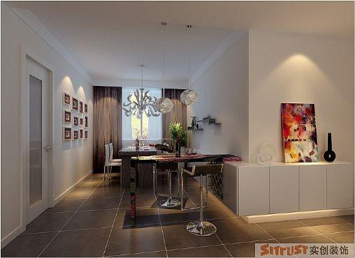 餐厅延续客厅的简约风格,围绕餐厅与客厅之间的墙面阳角打造L型储藏柜,增加客厅的储藏空间,搭配吧台与酒柜,空间变得活跃灵动,自然垂下的水晶灯像是重力下垂的细沙,感觉时间都慢了一个脚步。
