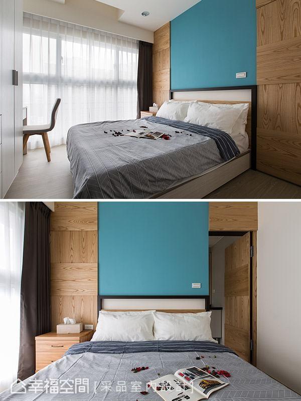 爽朗的天蓝色作为床头背墙,并以对称手法将卫浴的门片纳入整体立面设计。