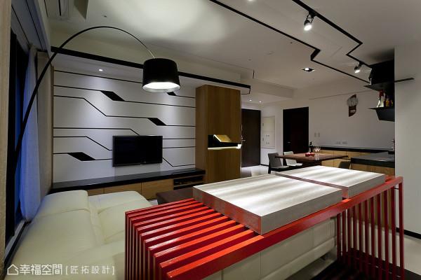 电视主墙以不规则的线条延续天花板的设计元素,匠拓设计交融出的现代时尚。