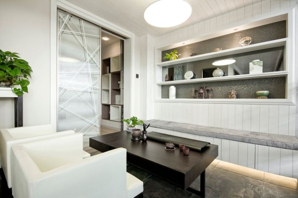 书房的设计,黑白的经典搭配,功能上的设计既可以聊天喝茶,同时兼备办公功能
