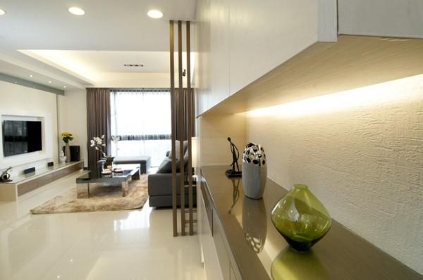 以不动格局为前提,白色圆形线条图腾旨趣的屏风设计为玄关端景,而木作格栅通透的效果成为与客厅的介质