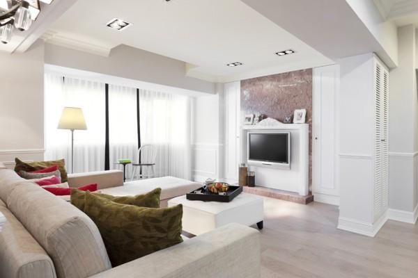 将原本的空间格局略作调整,让客厅主视觉看起来更为宽敞,同时因為加入白色调和,整体呈现明亮的透视感,电视墙后方则利用大理石为装饰,更显层次与优雅。