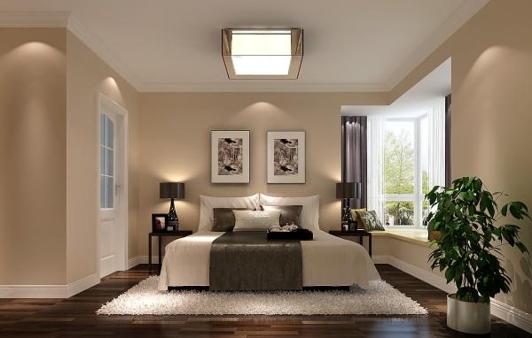其次将原有的卫生间改成一个衣帽间使之与主卧连为一体形成一个方便舒适的生活空间,米黄色的墙漆、深色的地板、白色的地毯、唯美的挂画营造一个浪漫温馨的生活情怀。