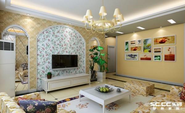 客厅使用一些自然的材质,花纹图腾的壁纸和沙发,来营造室内空间的乡村自然风情。电视背景用优雅细致的线条做框架,配以现代感的菱形镜,以明媚的色彩设计方案为主要色调,给人温馨舒适的感觉。