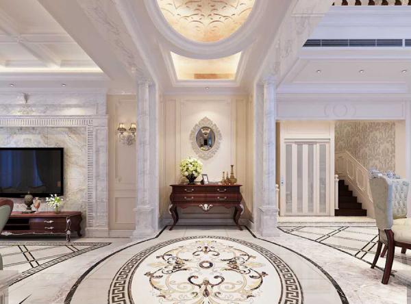 欧式风格玄关设计,设计师以精选石材拼出圆形图腾语汇的地面设计,与上方的白色石膏边圆形天花板相对应,让人一进门就能感受沉稳圆融的空间能量。