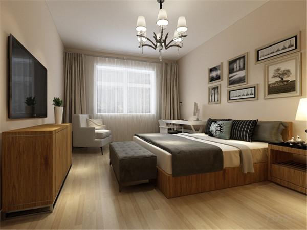 卧室的空间,选择了一组黑白画,和床的颜色搭配,增加重色。     合理的装饰不仅使空间可以充分利用,同时也增加人的幸福感,居住在这样的环境里面,洗去一天的劳累,好好享受幸福的时刻。