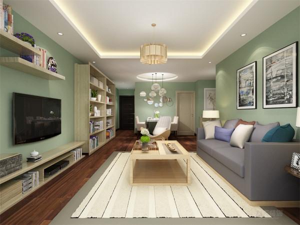 客厅的设计采用了木制家具,使人感到很亲切