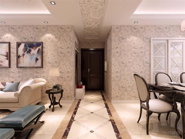 玄关处摆放了鞋柜与穿鞋凳,给业主出入带来方便,玄关的吊顶是浮雕的样式,体现了业主的品味。