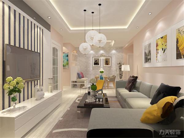 客厅设计采用简约明朗的线条,回形吊顶将空间进行了合理的分隔,增加了空间感,