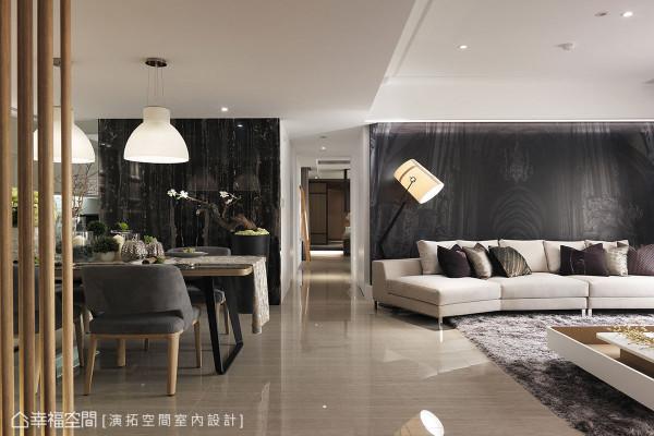 在一室的浅色调中,透过沙发背墙与餐厅主墙的黑,衔接起客厅与餐厅的关系。