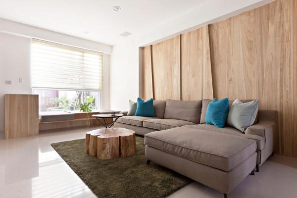 客厅沙发背墙以梧桐木铺陈,温润了整体空间氛围,并运用线条作层次的变化,塑造出视觉上的美感及重心。