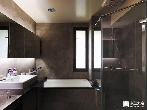 深色砖的卫浴,延续空间中沉稳静谧的氛围。