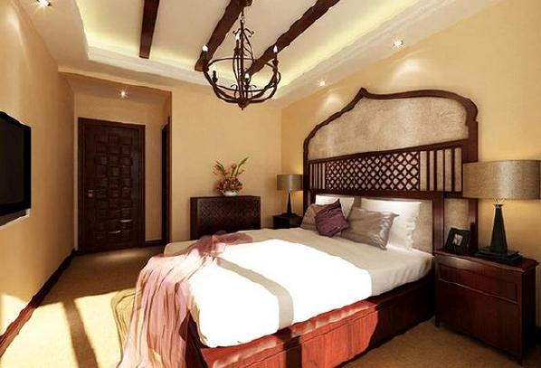 主卧室营造的气氛是非常符合主人气质的民族风。东方的浓郁浪漫迷漫整个空间,东南亚的香艳格调,于大俗大雅之间夺人眼球。