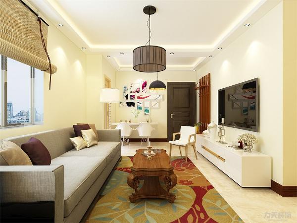 客厅设计讲究的是简约、稳重,深色的电视柜、浅色的茶几,沙发,餐桌使得整个空间即稳重又清新