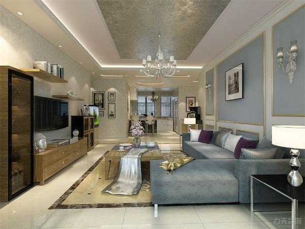 在本方案中,背景墙整体以蓝色壁纸为主,与沙发颜色相呼应。电视背景墙用柜子代替,从材料上区分不同,增加丰富性。