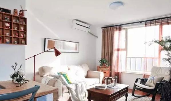 ▲ 整体色调温馨甜蜜,风格清新前卫,功能实用,客厅沙发背景简单舒适