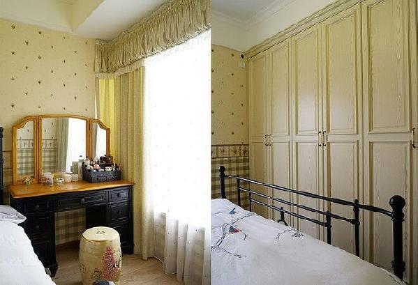主卧一面墙定制了一排衣柜完全解决了衣物搁置的问题