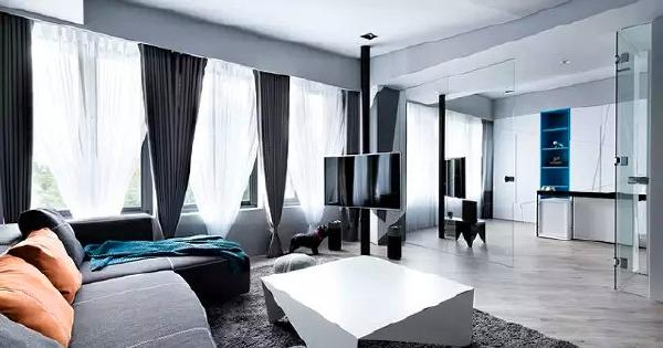 ▲ 大面积的窗户保证室内采光,书房和客厅之间采用玻璃隔断,视觉上空间相连,空间感更开阔