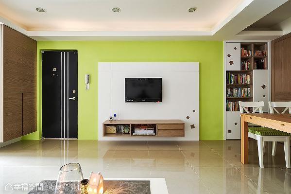 底墙铺陈明亮鲜艳的绿色调,白色烤漆的电视墙上,点缀镂空的几何造型,与一旁的书柜相呼应。
