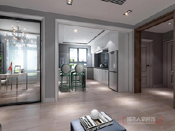 开放式的厨房带你回归真正的朋友圈,白色橱柜搭配深灰的墙面砖简约而不失大气,厨房和餐厅融为一体,增加了家人与朋友的互动性。
