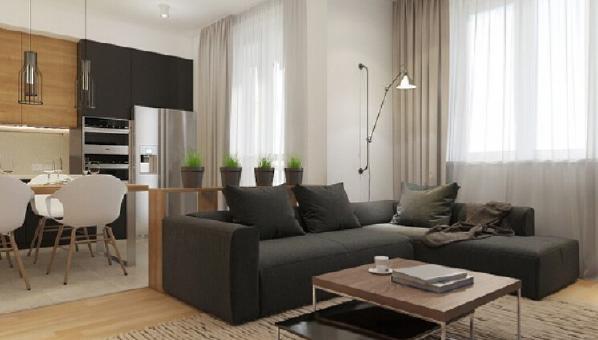 木质的地板与木质的家具相搭配,整体显得非常协调。长方形的木质茶几,展示出浓郁的日式恬淡。几株绿色植物,带来了一抹大自然的气息。