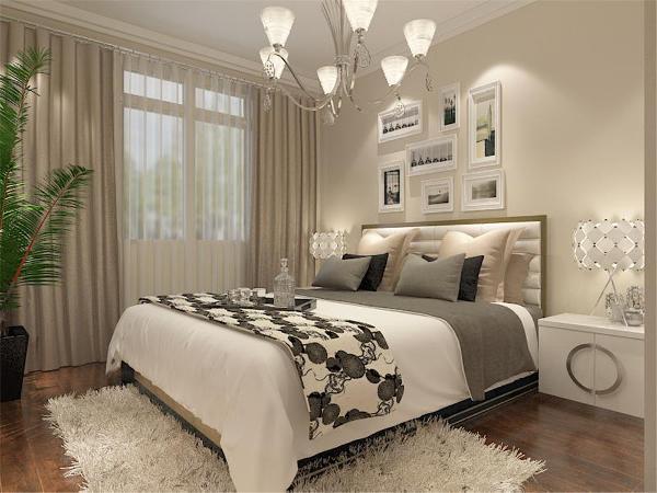 卧室背景墙面采用简洁的壁纸,其他墙面就是暖黄色乳胶漆。床头置放了一个床榻。地面采用暖黄色地板,墙上挂幅简约风格的画。做到简约不简单。