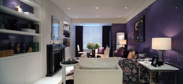 这种紫色大面积地运用到了背景墙的装饰中,并在其他小细节处加以映衬。这种色彩设计不仅不会使居室过于昏暗,还会有一种雅致的效果