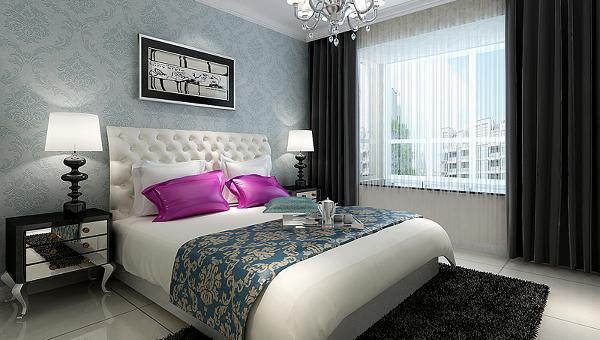 设计理念:淡蓝色壁纸配上白床黑柜,表现尊贵的同时还增添了几分现代感。与此同时,本案配搭了暖色的灯光,打破了传统布局沉闷的格调,使得空间的层次感、穿透性大大增强。将奢华的欧式风情演绎得淋漓尽致。