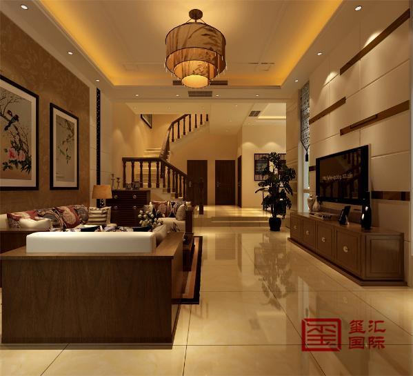 一楼客厅 客厅是主任品味的象征,体现了主人品格,地位,也是交友娱乐的场合,电视背景墙采用软包和金色咖镜搭配,既简单又大方