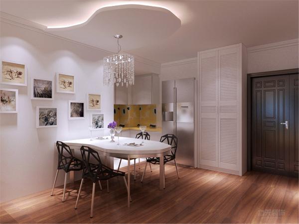 在餐厅的设计中,采用了白色系的餐桌椅搭配磨砂漆的黑色座椅。