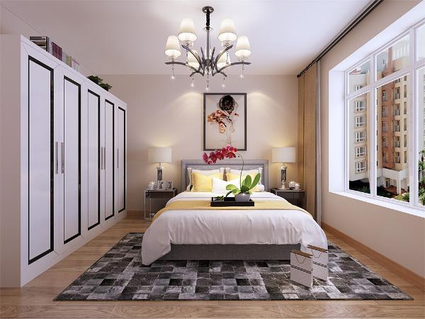 床的背景只是放了一副大的装饰画,很好的表达整个空间的时尚、个性。