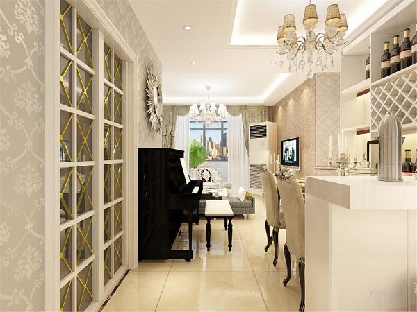 玄关鞋柜处采用的是挂画装饰,简单大气。运用水晶吊装饰。在地面设计上,也是具有设计感的,厨房运用的是白色橱柜,墙面运用的是瓷砖的拼接