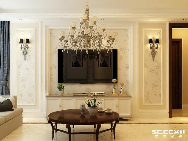 客厅的电视背景用采用石膏线与石膏板做出起伏纹理结合墙面颜色与配饰,打造了一个高端大气的客厅空间。